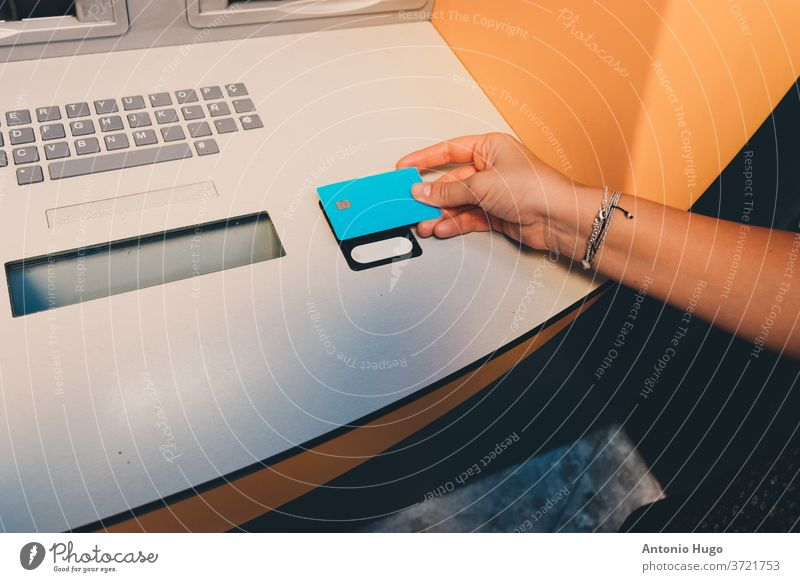 Woman's hand withdrawing cash from ATM with card atm withdrawal finance holding automated banking financial machine money savings security standing store