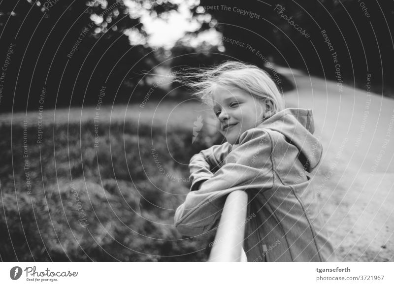 hair in the wind Child girl portrait windy fortunate happy child Laughter luck Contentment contented Infancy blowing hair Joy smile 8 - 13 years Human being