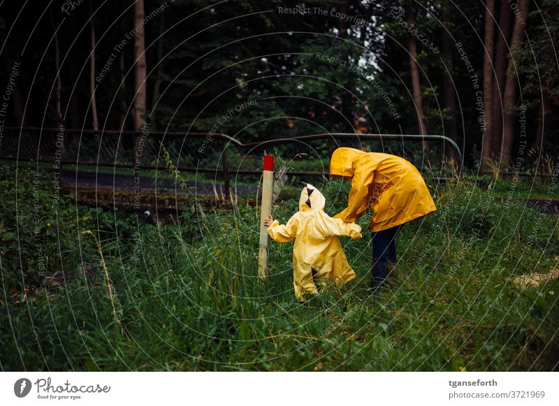 rainy days Child children Infancy Discover Playing Rain Rain jacket Brothers and sisters brotherly love Colour photo Together Exterior shot Bad weather out