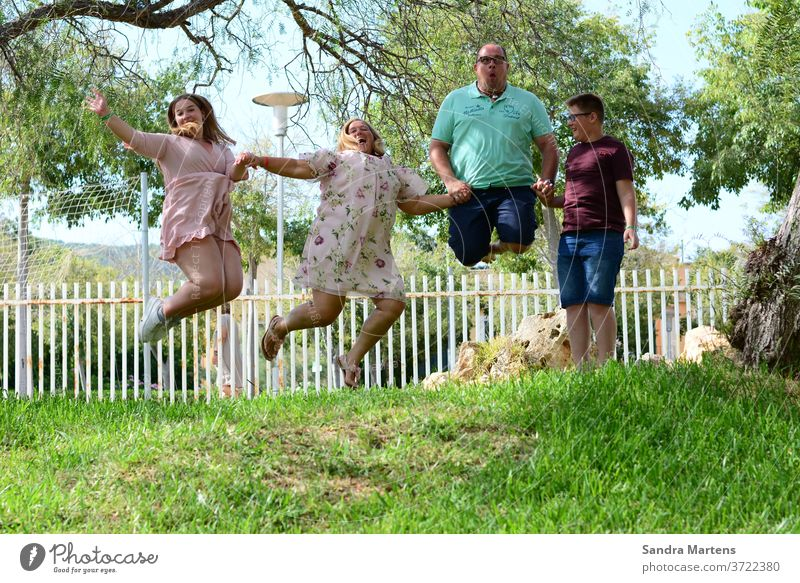 happy family Family jumps in the air Happy family family vacation Mother Father Daughter Son Crazy Family Vacation photo