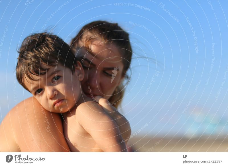 mother holding a child in her arms Mother Beach vacation Joy Warm-heartedness Serene Calm Sunlight Sadness Time Longing Endurance Contact Summer Mother's Day
