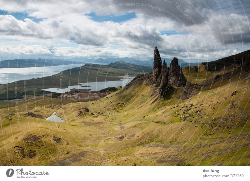 old man of storr Landscape Elements Earth Clouds Summer Beautiful weather Hill Lakeside Rock Heathland Old Famousness Sharp-edged Point Wild Brown Gray Green