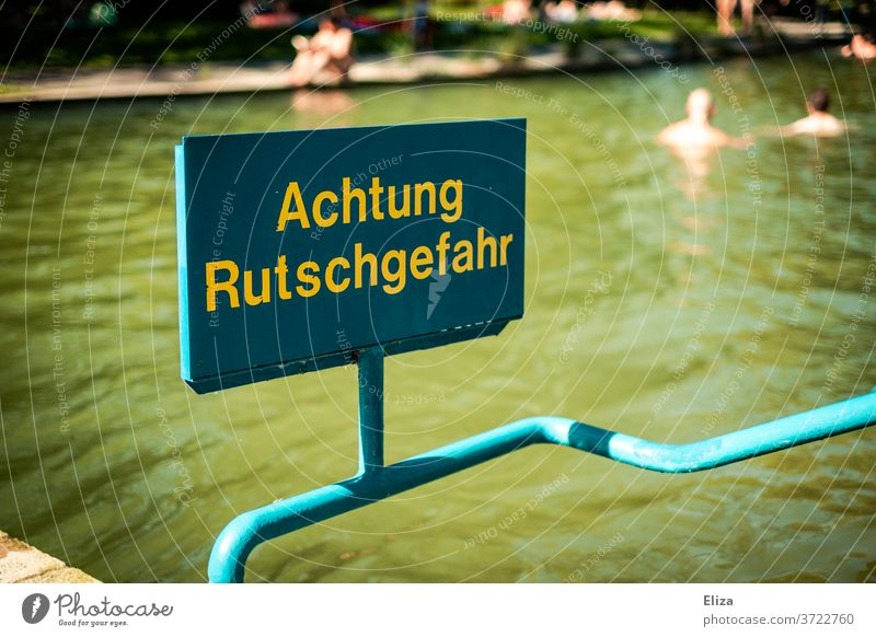 Watch out slippery! Slippery surface Swimming pool peril Risk Summer squidgy Pool border Water Dangerous Wet Signage Warning sign Threat Safety Caution