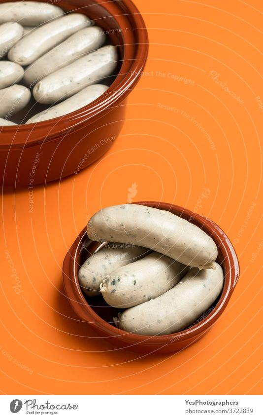 German white sausage in ceramic bowl. Bavarian veal sausage. Traditional food Germany Oktoberfest background bavarian boiled breakfast brown ceramic pot cooked