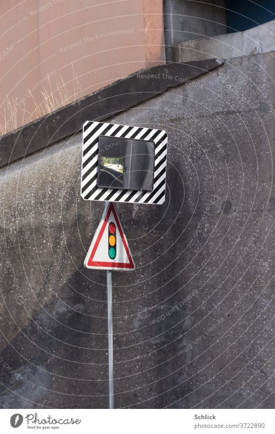 Traffic mirror and traffic sign Traffic light in front of concrete wall of an underpass traffic mirrors Traffic sign traffic light Road sign Mirror