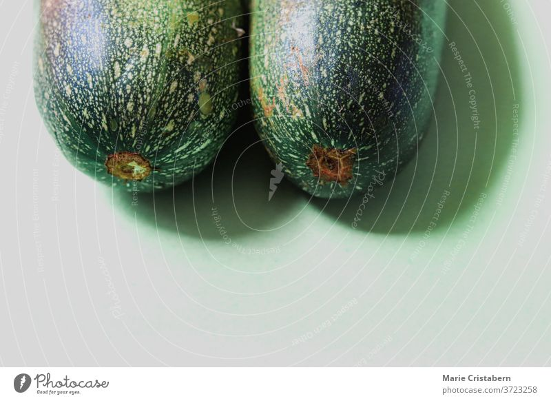 Close up of fresh green zucchini, showing concept of veganism, nutrition and wellness food and nutrition isolated design asset food and wellness