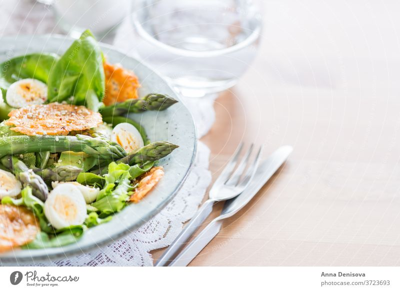 Asparagus Salad with quails eggs and cheese crisps asparagus salad quail egg healthy avocado detox gruyere green food vegetable gourmet vegetarian appetizer