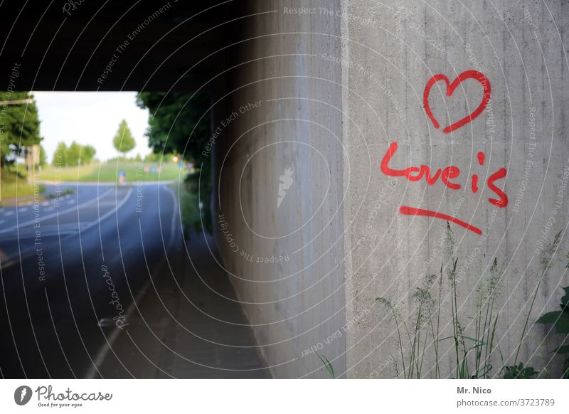 Love is ... Graffiti Declaration of love writing symbol Heart sensation lettering Romance Sign Infatuation Characters Display of affection With love sprayed