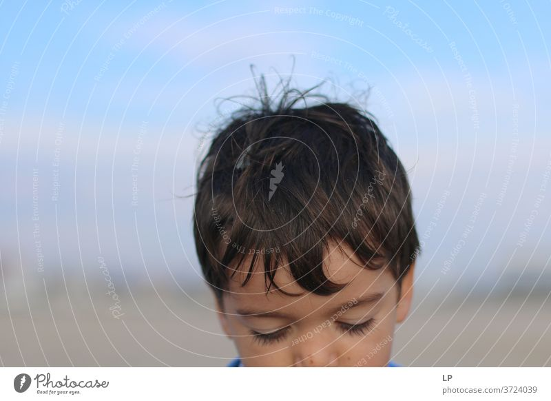 head of a sad boy Head Boy (child) Child Baby thinking looking down Sadness ideas Neutral Background Copy Space top Abstract Experimental Detail Subdued colour
