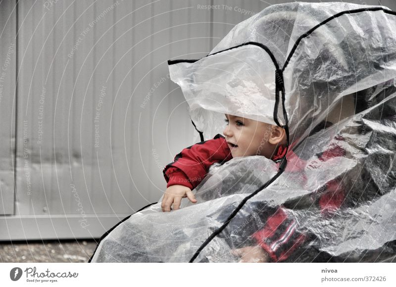 Weatherproof Masculine Child Boy (child) Head 1 Human being 1 - 3 years Toddler Bad weather Rain Baby carriage Jacket Umbrella Observe Driving Looking Curiosity