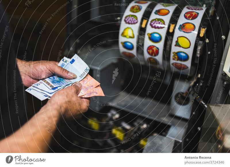 Man collects money from slot machines. Close-up of collecting machine. man repairing job work worker vice game economy gambling raise maintenance collection