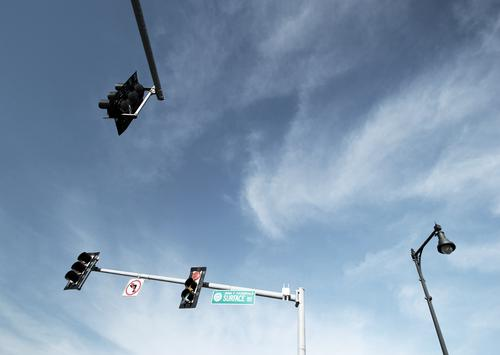 light boxes (19) Traffic light lamps Sky Clouds Pole Lighting Public Transport cross street sign Orientation Above Tall at the same time in common sunny