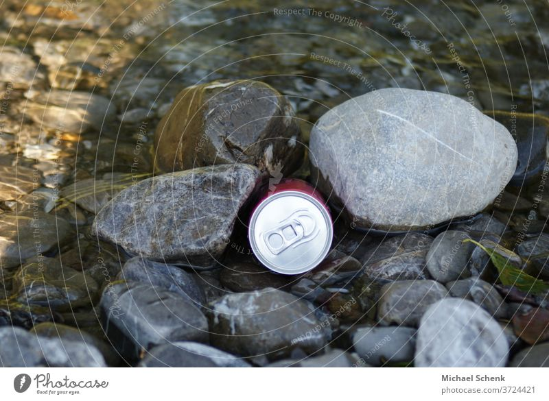A beverage can between stones at a mountain stream Cans, stones, water, streams, mountains, Exterior shot Colour photo Adventure Exceptional Stone Brook Alps