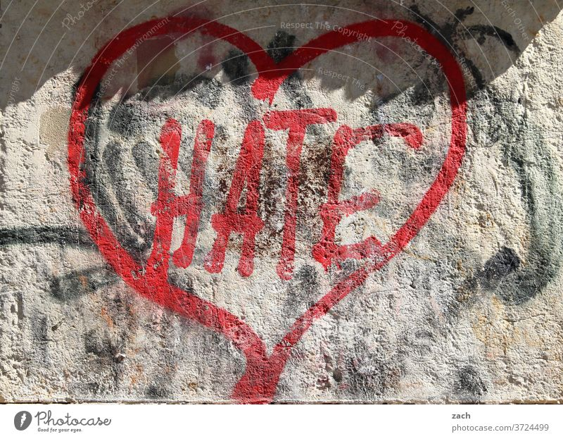 love & hate Graffiti street art Wall (barrier) Mural painting Facade embassy Letters (alphabet) Digits and numbers Love Heart Romance Hatred furious