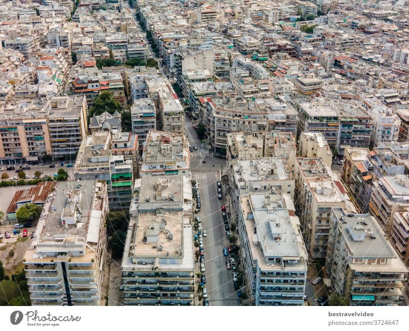 Thessaloniki, Greece aerial drone landscape view of Analipsi borough buildings rooftops. Day top panorama of European city with residential blocks of flats around road on a sunny day.