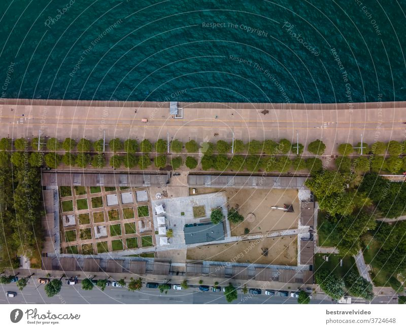 Thessaloniki, Greece aerial drone landscape view of renovated waterfront with bikeway. Day top panorama of European city with greenery & pedestrian area promenade before a calm seafront.