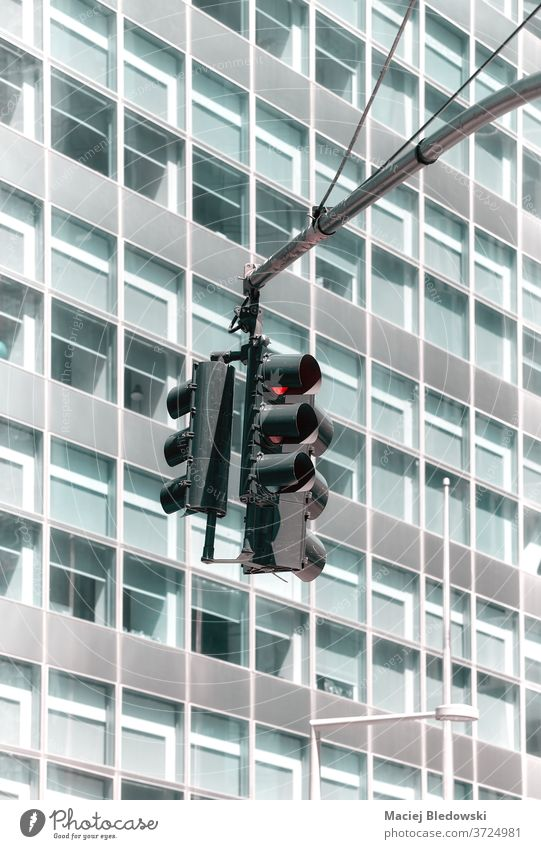 Traffic lights with a modern office building in background. traffic city signal stoplights transport safety no people lighting equipment traffic lights