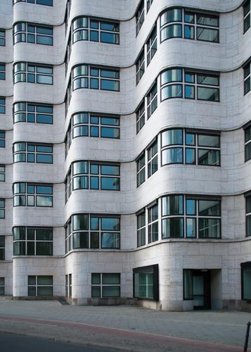 Facade seen soberly Architecture Office building Window Tourist Attraction Exceptional Retro Original Esthetic Agreed shell house Structures and shapes
