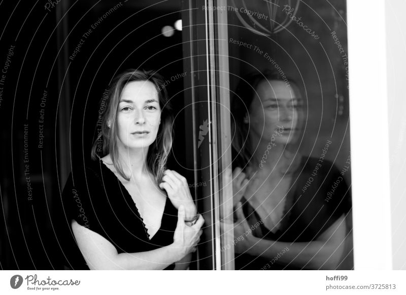The woman and her reflection portrait Adults Young woman Feminine Style Black & white photo melancholy Movement Mysterious Emotions Head Think Meditative Dream