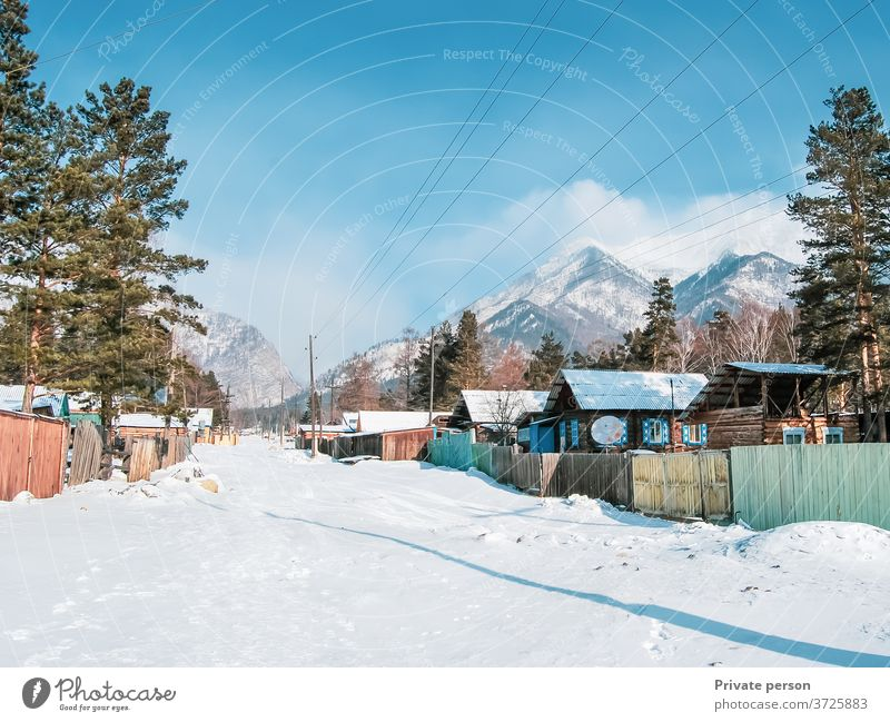 Village at the foot of the mountains in winter. Winter Snow Landscape countryside fresh air ecology healthy lifestyle tranquility old house wooden hut scenic