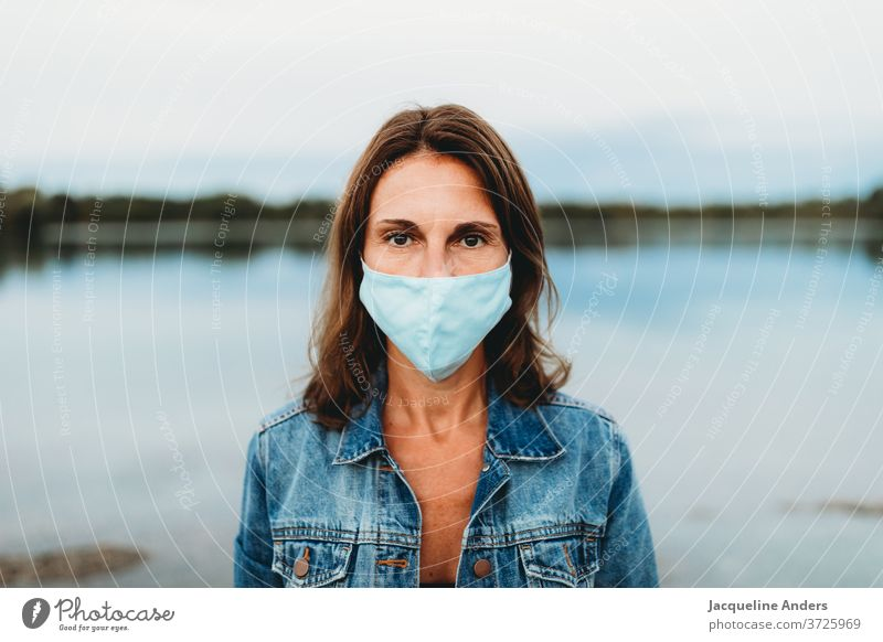Woman wearing mouthguards in the Corona Pandemic Mask Face mask Protection coronavirus covid-19 pandemic COVID Virus Risk of infection Corona virus prevention