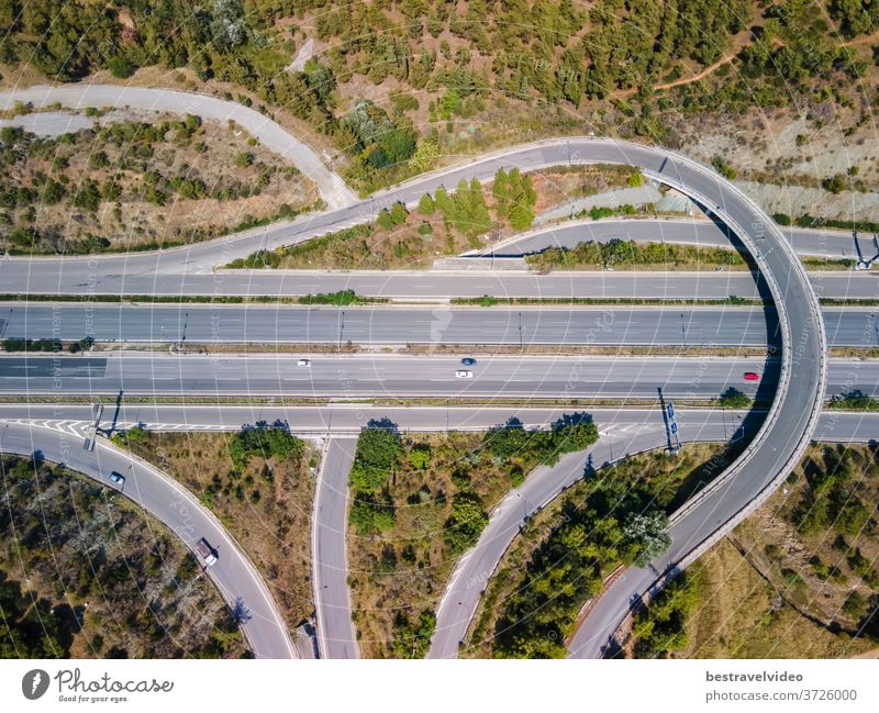 Thessaloniki, Greece aerial drone landscape of interchange traffic on Periferiaki inner ring road. Day top panorama of European multi-level stack highway junction with passing cars through forest.