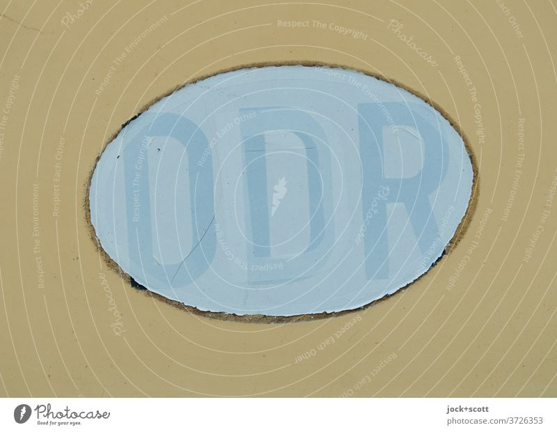 Number plate GDR Illustration Germany Oval Past Change Subdued colour Weathered Ravages of time Neutral Background Transience pasted over Translucent