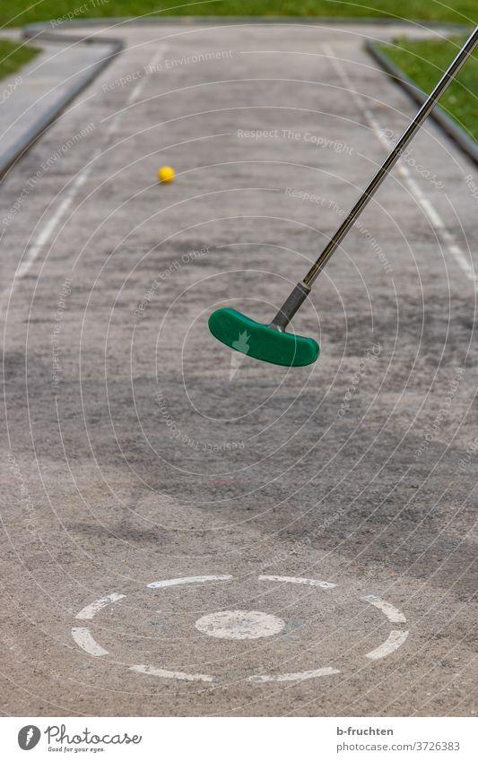 play miniature golf Mini golf Leisure and hobbies Golf Mini golfclub miniature golf course Beat Playing Exterior shot Ball Golf ball Summer Success Sports Point