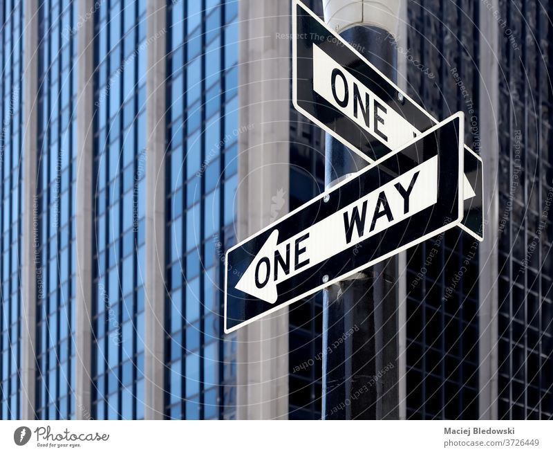 One way street traffic signs in New York City, USA. new york city manhattan one way us road urban direction concept choice arrow decision black white building