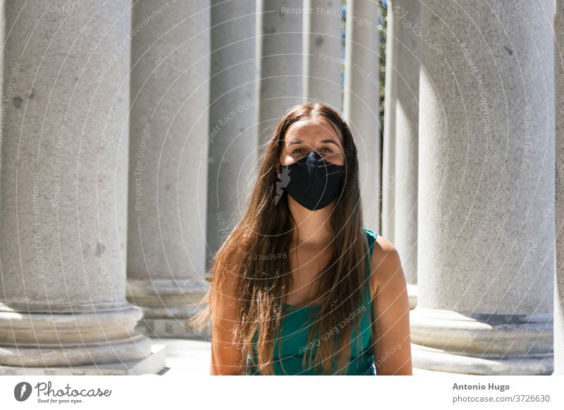Young blonde woman wearing a protective mask against the virus at the Retiro Park in Madrid madrid retiro masked corona person epidemic protection portrait