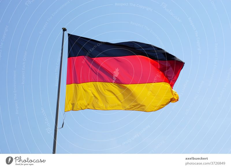 Flag of Germany against clear sky flag germany national black red gold yellow waving flagged banner federal republic color colour tricolour tricoloreurope