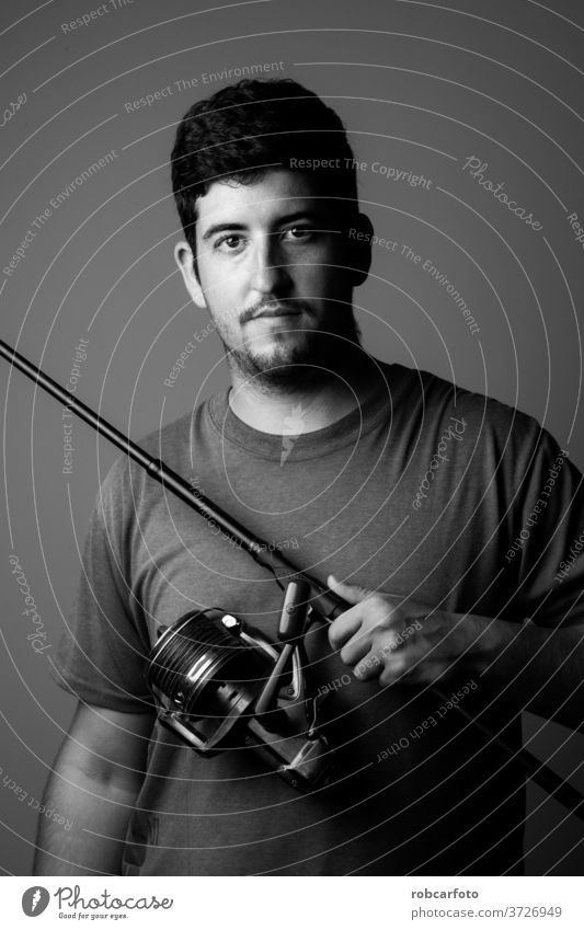 portrait river fisherman with fishing rod sport person relaxation recreation nature lake angler reel people catch casting summer male fun water equipment one