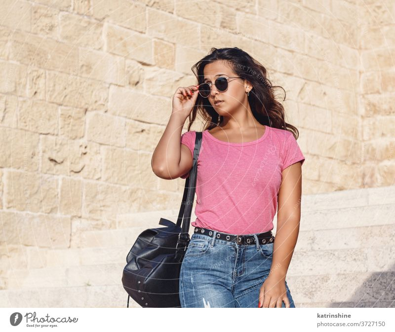 Young women going down the stairs and touch sunglasses girl wear mockup t-shirt jeans swatch round neck apparelmockup casual mock up longhair Person Outdoor