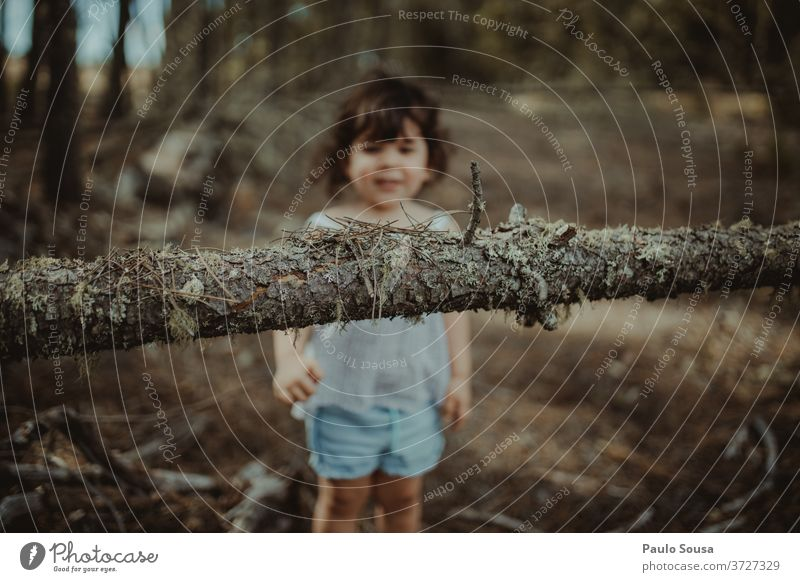 Little girl playing in the woods Child Children's game childhood Tree trunk Trunk having fun kids Toddler lifestyle Infancy Colour photo Playing happy