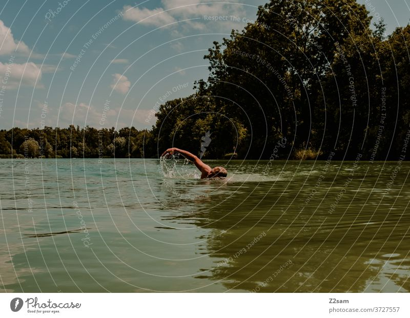 Pensioners crawling in the lake be afloat free time annuity Summer Lake Body of water Water Sports Movement nose clip Athletic Brown age Man portrait