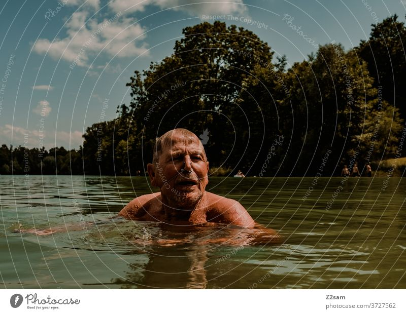 Pensioners swimming in the lake be afloat free time annuity Summer Lake Body of water Water Sports Movement nose clip Athletic Brown age Man portrait