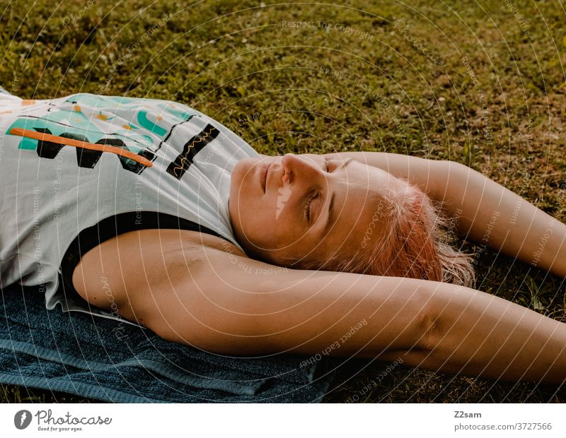 Young woman relaxing in the meadow relaxation Woman rest equalization Summer Sun Meadow Nature Lie Dream Sleep Relaxation youthful feminine Athletic yoga