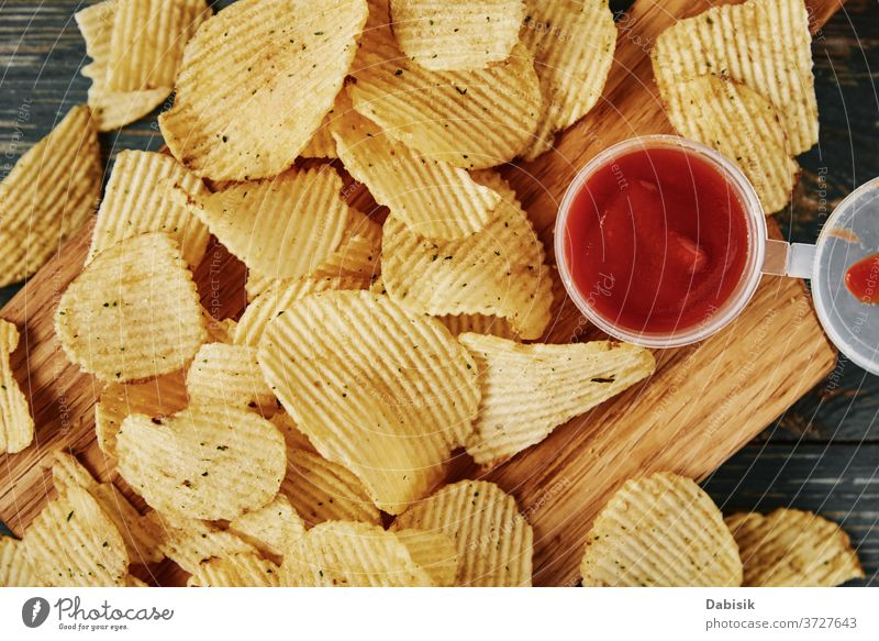 Potato chips and sauce on the table, close up junk unhealthy food calories clipping crisp crispy crunchy delicious fast fat flat fried potato background eat