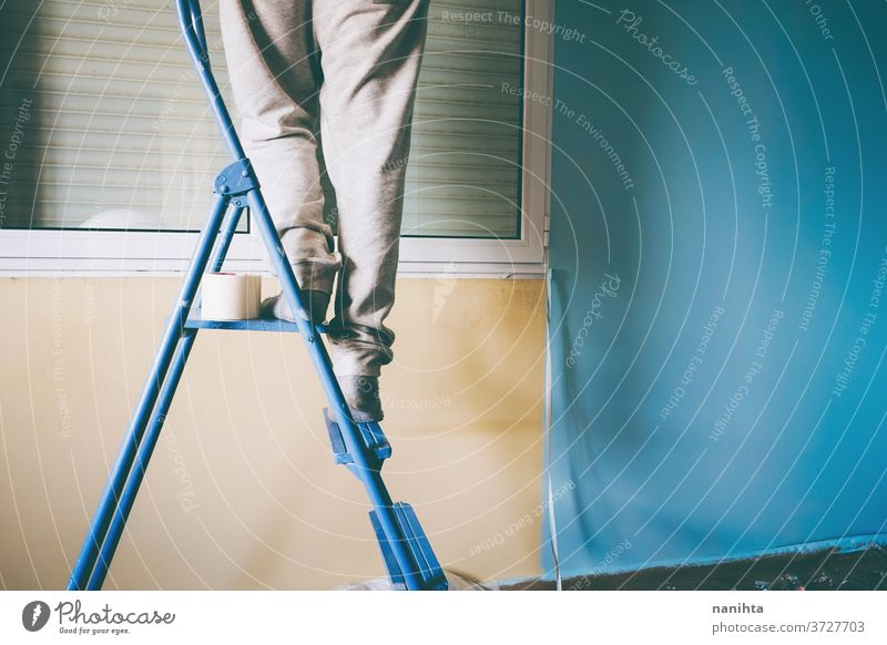 Man working in a room renovation reform home job house paint man male home improvement move removal relocation hard work work at home leisure active stairs