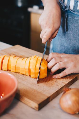 Butternut pumpkin being cut with chef's knife butternut pumpkin Pumpkin Food Food photograph food styling Food And Drink Vegan diet Vegan Food veganism cuisine