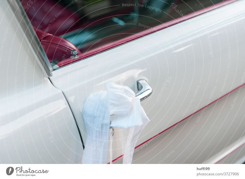 Bridal veil on the door handle of a white Mustang with red interior car door handle Mustang, Red Leather seat get married Car Vintage car luck Future wish