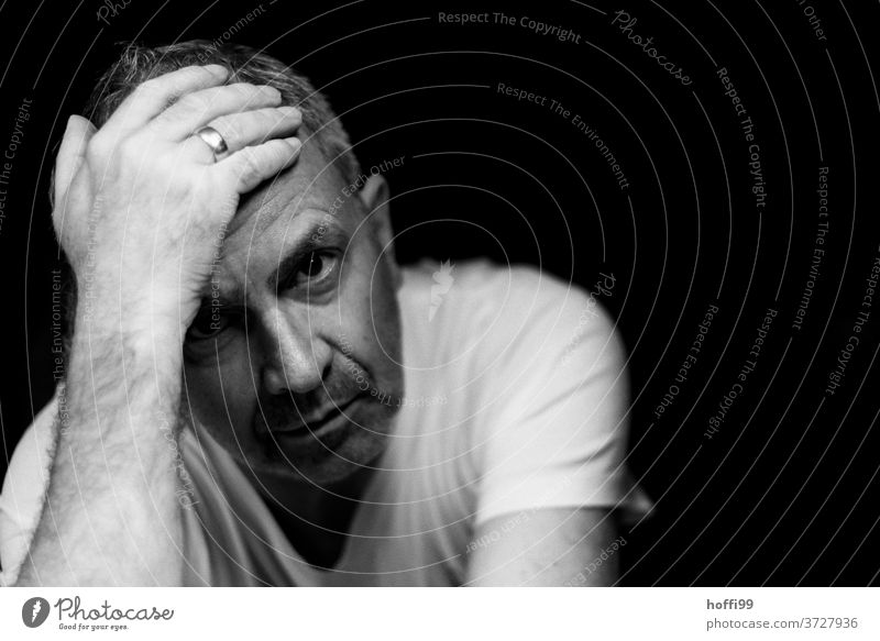 the man looks doubtfully into the camera - so much going on around us portrait Head Adults Think Lifestyle Authentic Esthetic Black & white photo Masculine