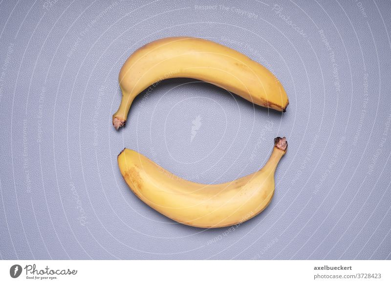 two bananas forming circle shape fruit food topview top view above overhead yellow healthy ripe sweet nobody snack vitamin nutrition diet organic object