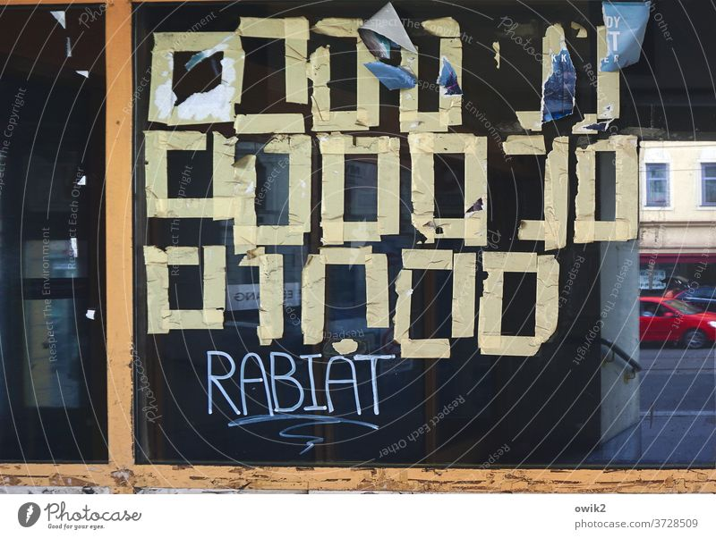 Cipher Shop window Plastered remnants Squares Mysterious reflection Hebrew Unfamiliar Sign Glass RemaindersPaper Adhesive tape adhere Reflection Window puzzling