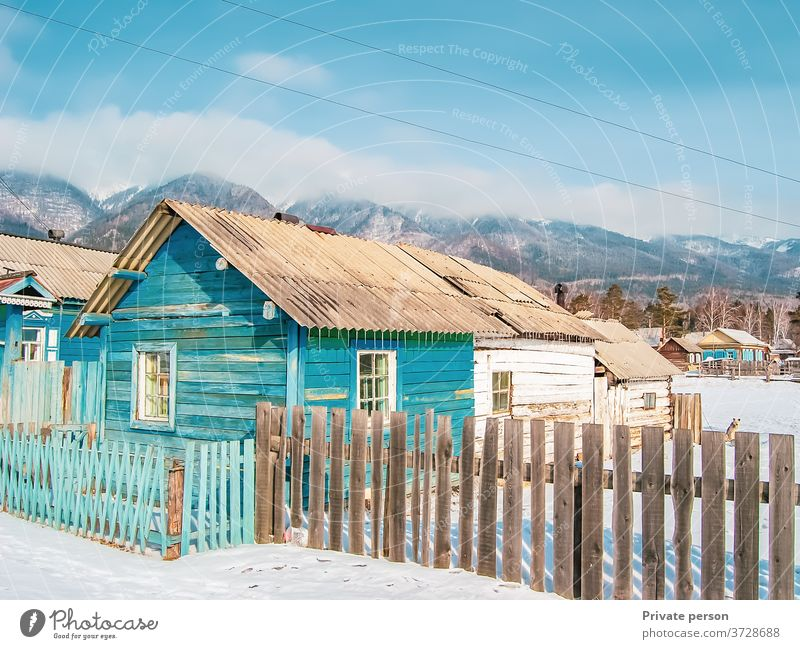 wooden house at the foot of the mountains, wild life, winter background.  village. architecture beautiful blue cold europe frost vintage travel landscape nature