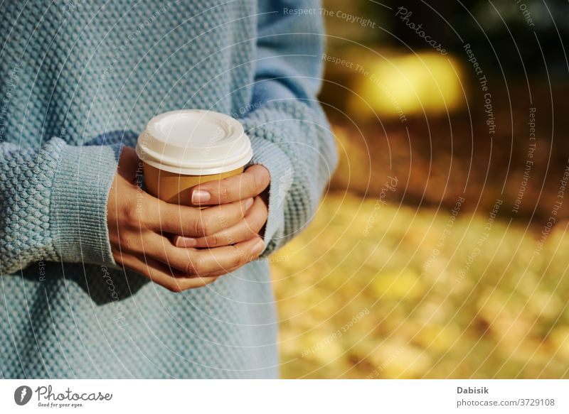 woman hold cup of coffe takeaway in the autumn park coffee outdoor tea drink disposable female paper hand go hot morning latte holding leaves orange tree nature