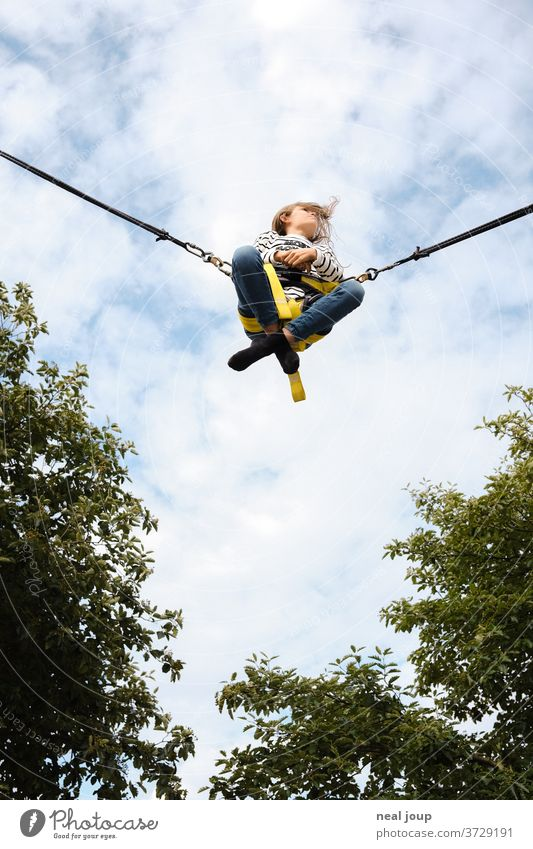 Girl flies in the sky - Rocket Bungee Flying cheerful Free Freedom Ease Easygoing Sit Cross Legged free time pleasure Exterior shot Sky Leisure and hobbies