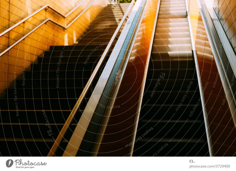 stairs and escalator Stairs Escalator Upward handrail Banister stagger sloth Architecture Subway station up and down urban Yellow Esthetic Deserted Colour photo