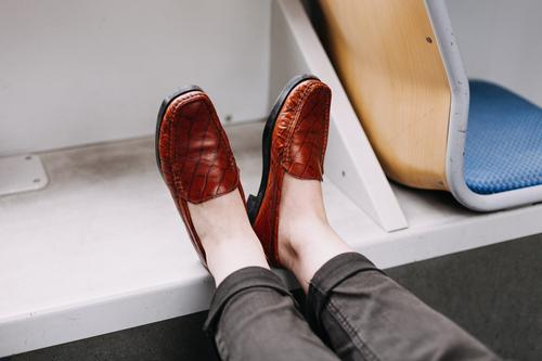 in the train Footwear Old fashioned Train travel Track Tram Pants Public transit Feet up relax relaxation Seat Leather Legs legs high Seating rest tired legs