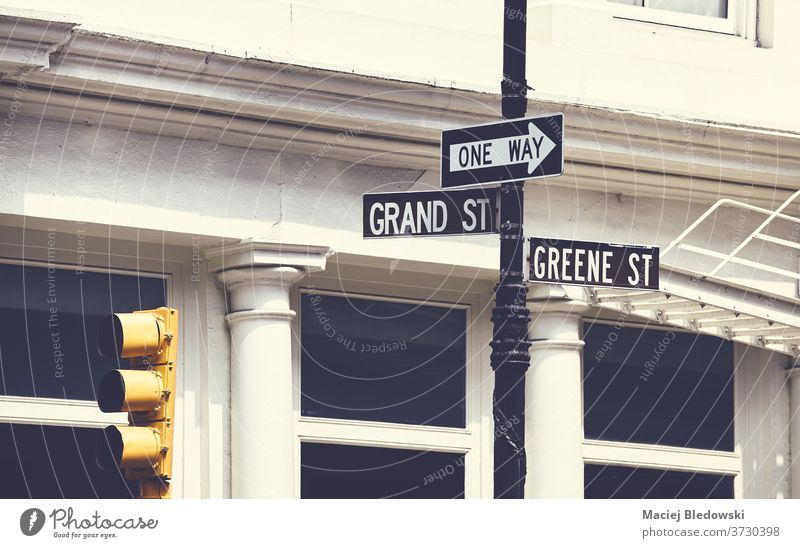 Grand and Greene Street signs in New York City, USA. city street traffic light Manhattan one way Grand Street retro vintage urban United States NYC new york